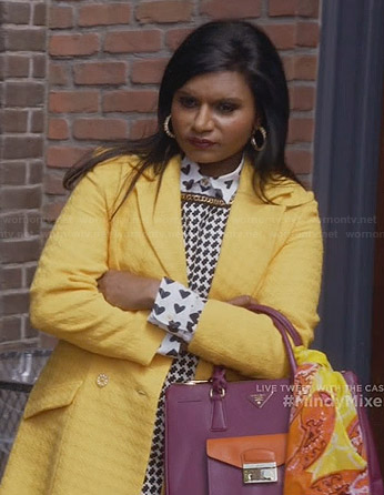 Mindy's canary yellow coat, houndstooth dress, heart print shirt and pink bag on The Mindy Project