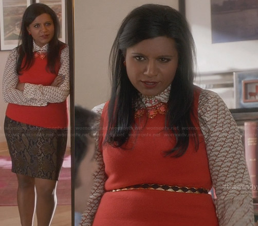 Mindy's orange printed shirt and snake print skirt on The Mindy Project