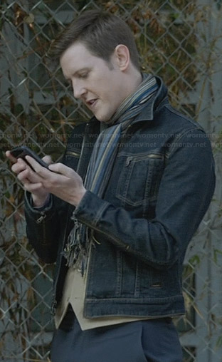 Nolan's denim zip-pocket jacket and striped scarf on Revenge