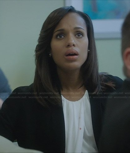 Olivia's white pleated front top and black jacket on Scandal