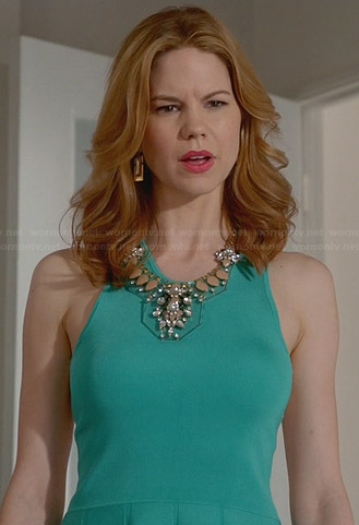 Peri's turquoise green fit and flare dress with white back on Devious Maids