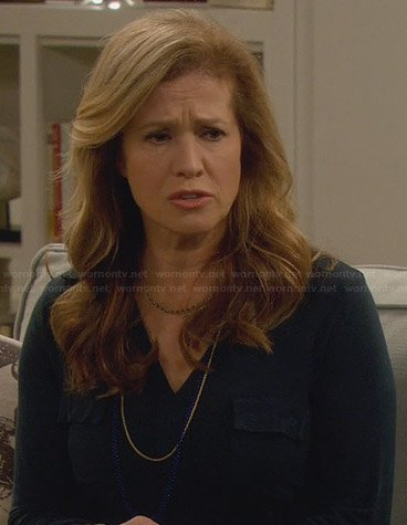Vanessa's black henley shirt on Last Man Standing