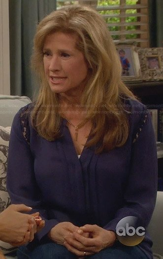Vanessa's blue pleated front blouse with lace inserts on Last Man Standing