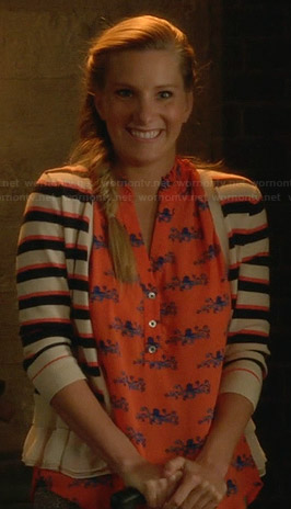 Brittany's orange octopus print top and striped cardigan on Glee