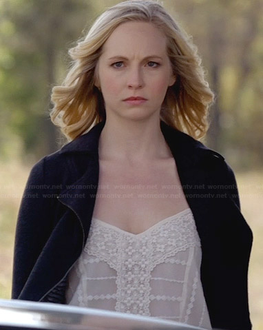 Caroline's white embroidered top and black moto jacket on The Vampire Diaries