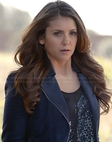 Elena's printed top, blue jacket and