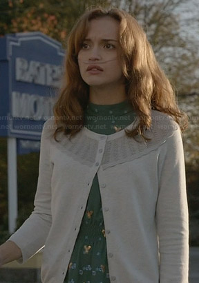 Emma's green and blue dress with sequins and white cardigan on Bates Motel
