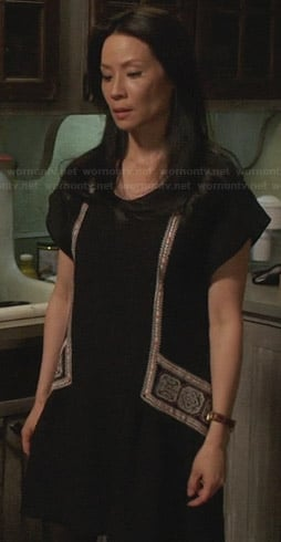 Joan's black embroidered dress on Elementary