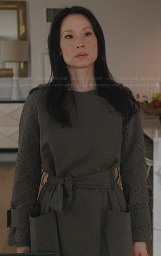Joan's grey coat with perforated sleeves on Elementary