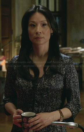Joan's printed three quarter sleeve dress on Elementary