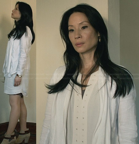Joan's white studded trim dress and cardigan and ankle boots on Elementary