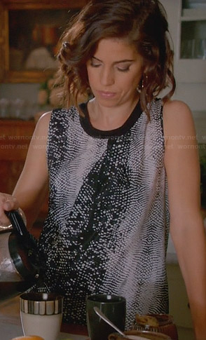 Marisol's black and white snake print top on Devious Maids