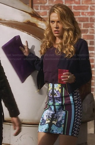 Taylor's mirrored print skirt, purple layered top and navy zip jacket on Star-Crossed