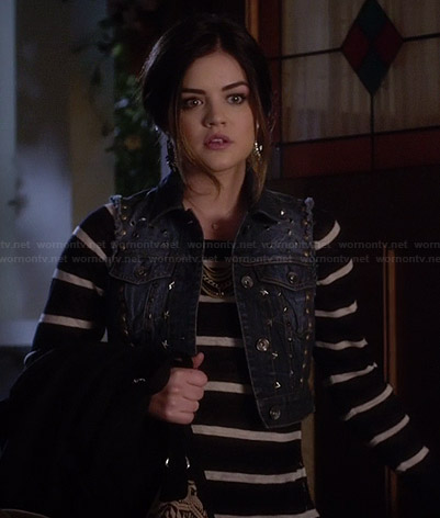 Aria's striped sweater and studded denim vest on Pretty Little Liars