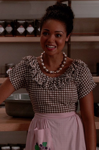 Beth's brown houndstooth ruffled dress and pearl necklace on Chasing Life