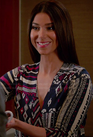 Carmen's navy and pink geometric patterned wrap top on Devious Maids