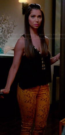 Carmen's yellow leather look pants and black beaded top on Devious Maids