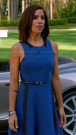 Marisol's blue fit and flare dress with leather trim on Devious Maids