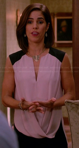 Marisol's light pink draped front top with black shoulders on Devious Maids