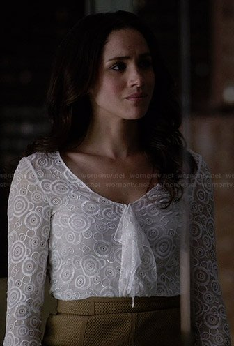 Rachel's white circle embroidered ruffle front top on Suits