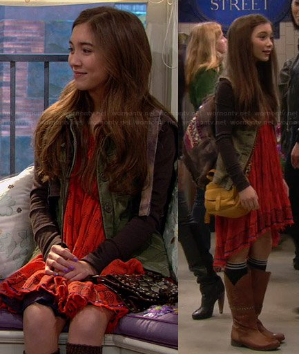 Riley's orange printed dress, green jacket, tan boots and embellished backpack on Girl Meets World