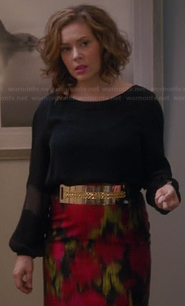 Savi's black blouse and red ikat print skirt on Mistresses