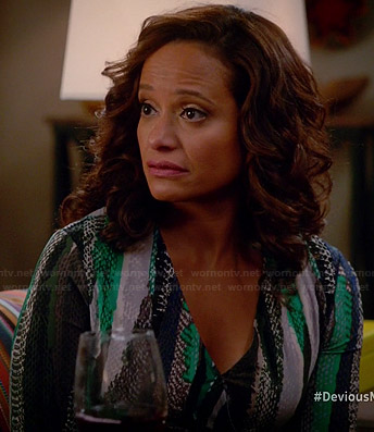 Zoila's blue and green snake printed wrap dress on Devious Maids