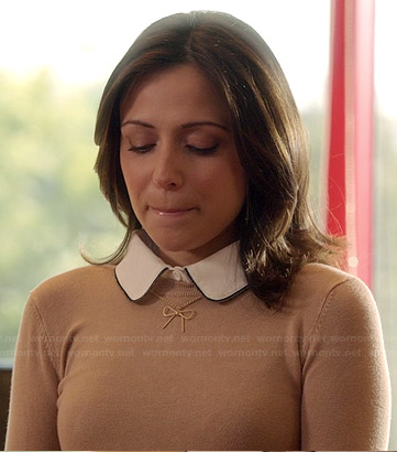 April's beige sweater and gold bow necklace on Chasing Life