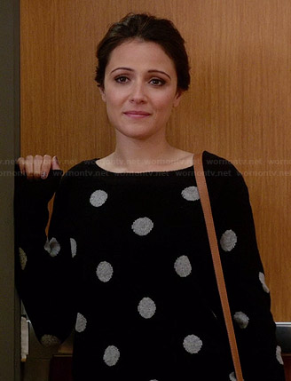 April's black and white polka dot sweater on Chasing Life