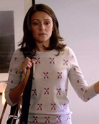 April's grey sweater with pink and purple embroidered flowers on Chasing Life