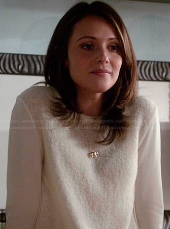 April's white sweater with sheer sleeves and gold elephant necklace on Chasing Life