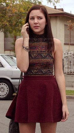 Brenna's paisley printed crop top and burgundy cirle skirt on Chasing Life