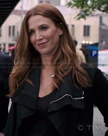 Carrie's black leather jacket on Unforgettable