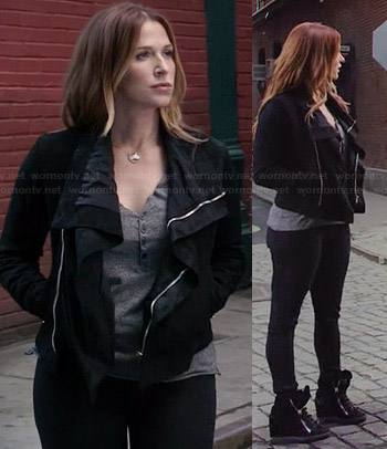 Carrie's black shawl collar leather jacket and wedged sneakers on Unforgettable