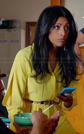 Divya's orange ikat printed henley blouse on Royal Pains