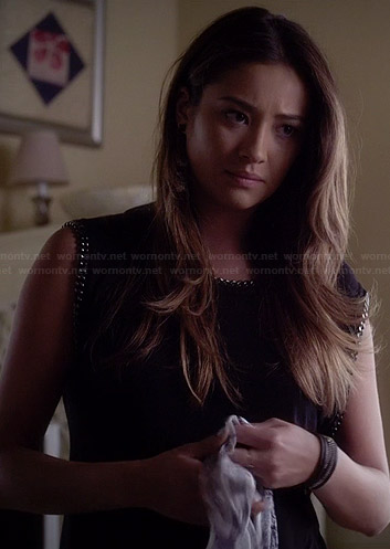 Emily's black chain trimmed top on Pretty Little Liars