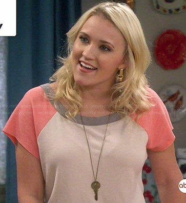 Gabi's white and peach baseball top on Young and Hungry
