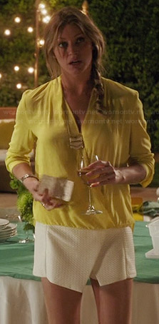 Josslyn's yellow draped front top and white asymmetric skort on Mistresses