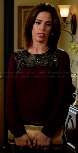Marisol's burgundy blouse with leather cutout yoke on Devious Maids