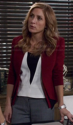 Maura's white top with black triangle and burgundy blazer on Rizzoli and Isles