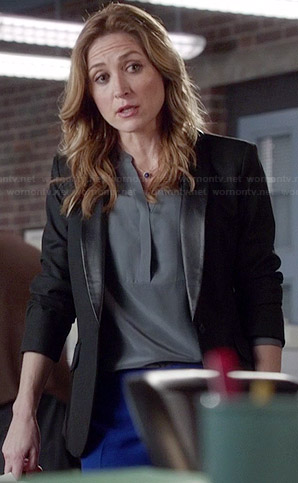 Maura's grey split neck blouse and leather lapel blazer on Rizzoli and Isles