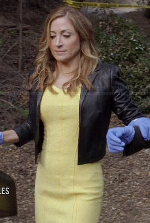 Maura's yellow dress and cropped leather jacket on Rizzoli and Isles