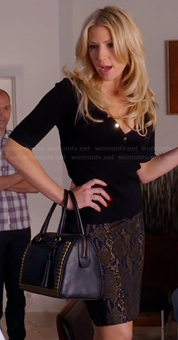 Meredith's black sweater with gold buttons, snake print skirt and studded bag on Bad Teacher