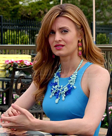 Paige's blue fit and flare dress with two toned necklace on Royal Pains