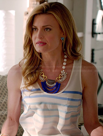 Paige's white ombre striped tank top and blue statement necklace on Royal Pains