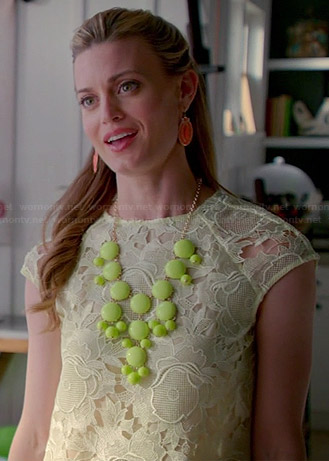 Paige's yellow lace top and lime green statement necklace on Royal Pains