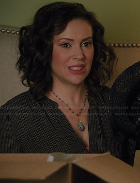 Savi's black printed split neck blouse on Mistresses