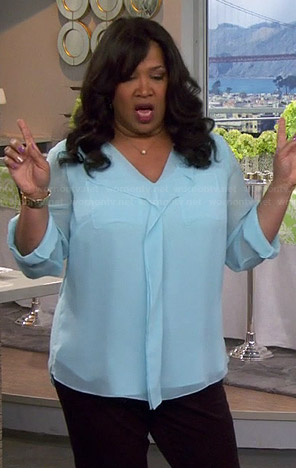Yolanda's light blue ruffle front blouse on Young and Hungry