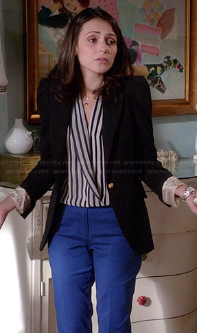 April's black and white striped wrap blouse and blue trousers on Chasing Life