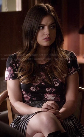 Aria's black floral top and striped skirt on Pretty Little Liars